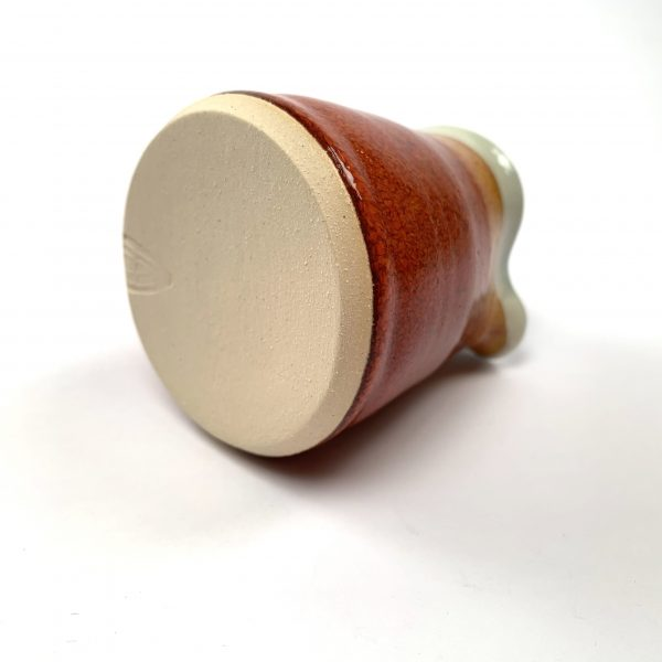 Bottom view of small ceramic creamer
