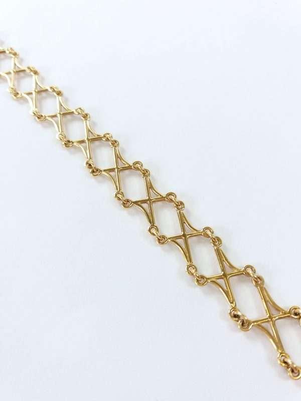 Close up of gold bracelet on white background
