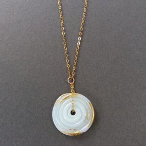Pale blue and gold disc pendant on gold chain