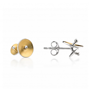 Two stud earrings, one front view and one side view, silver and 22ct gold.