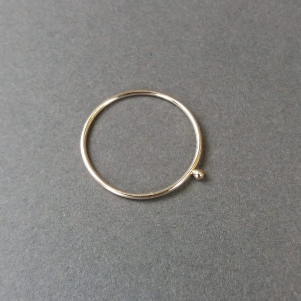 Very thin gold ring with little gold ball detail