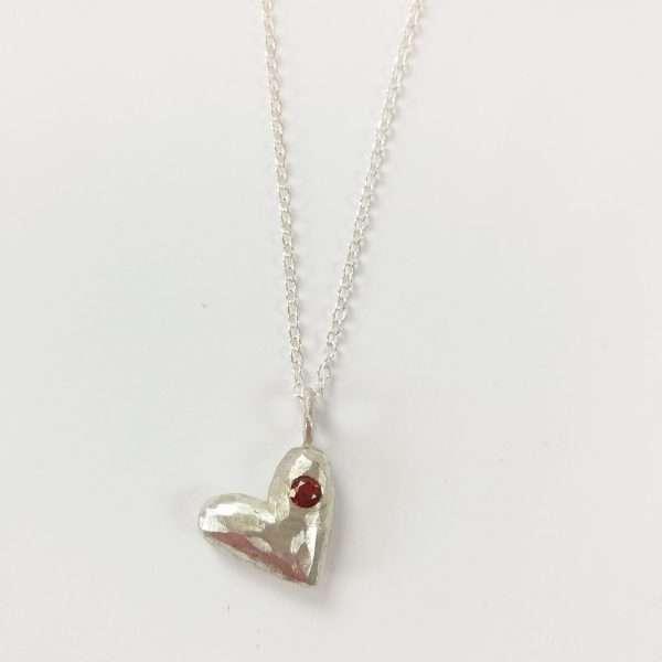 Silver and garnet pendant