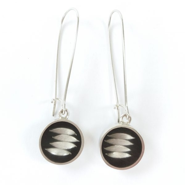 Silver bezel filled with resin with silver leaves on black background earrings