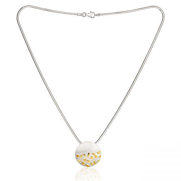 Silver and gold necklace on white background
