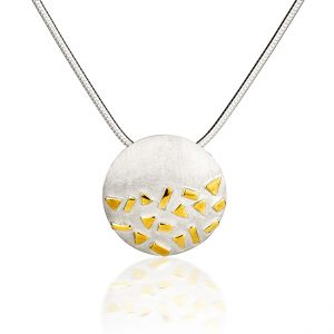 Silver and gold pendant on white background