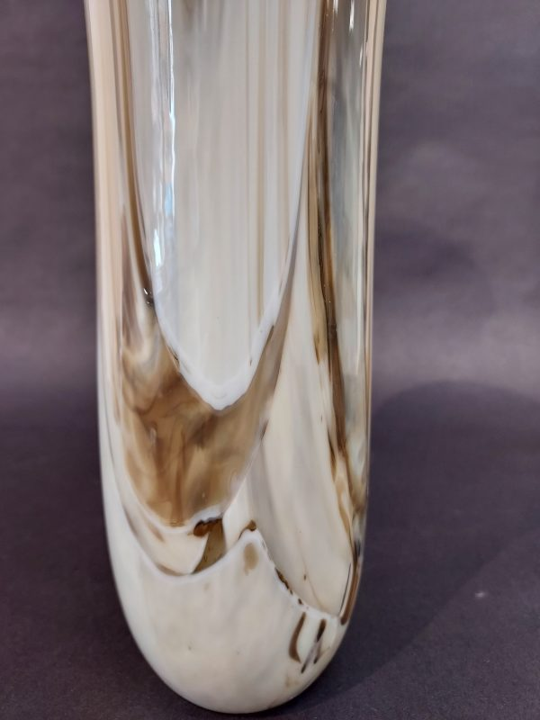 Detail of patter in glass cream brown vase