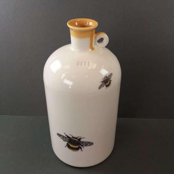 Porcelain bee bottle on grey background