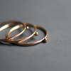 Gold solitaire stacking rings