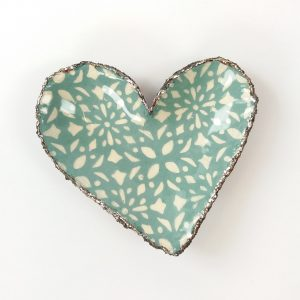 Ceramic heart dish green white pattern on white background