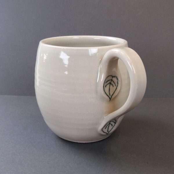 Ceramic mug with leaf detail