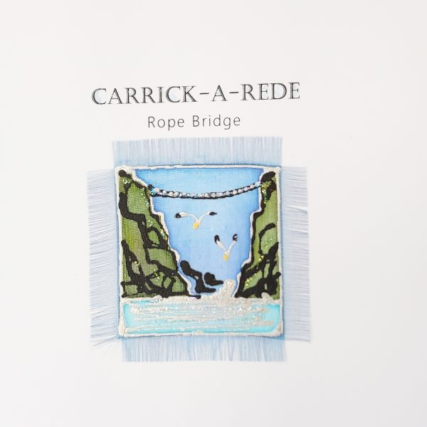 Detail of hand painted silk card featuring carrick-a-rede rope bridge