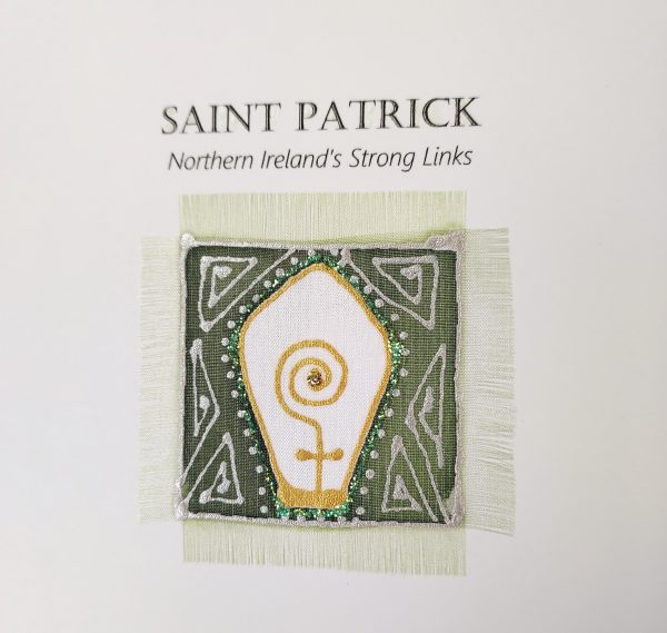 Detail of hand painted silk greeting card featuring St Patrick design
