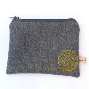 grey textile zip purse ball of yarn embroidered detail