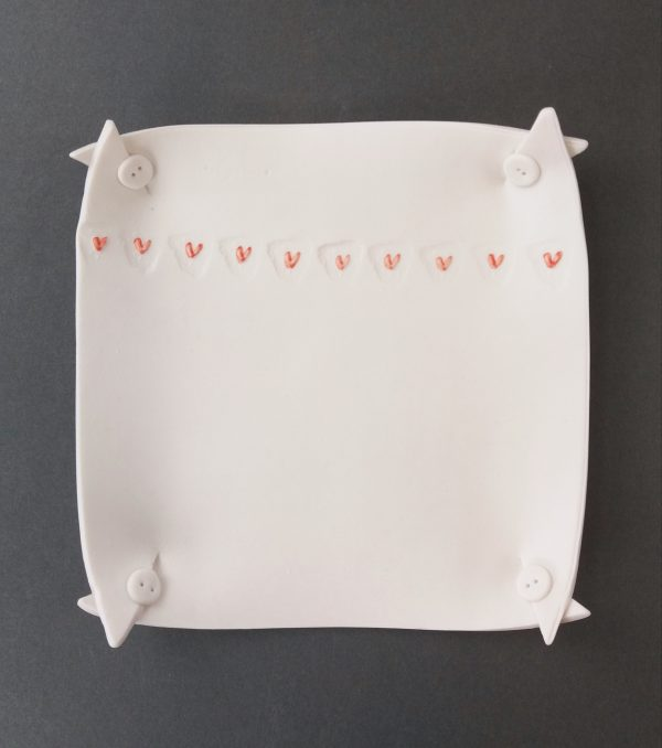 Square porcelain jewellery tray decorated with hearts