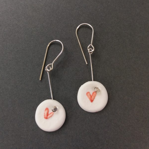 Round porcelain earrings with heart design
