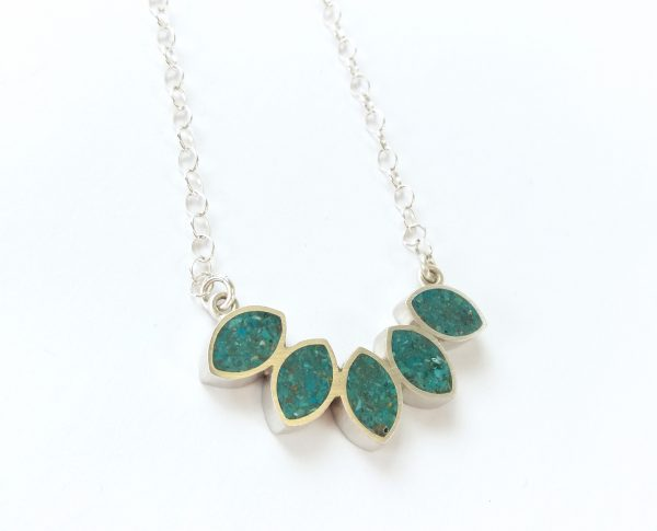 Silver leaf shaped pendant filled with ground turquoise set in resin, on silver chain.