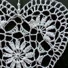 Close up detail of White crocheted heart