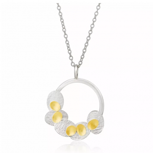 Round silver pendant with 22ct gold detail