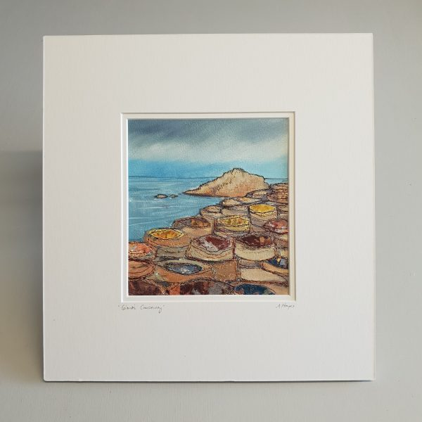 Textile art piece mounted, unframed depicting giant's causeway