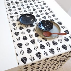 Leaf pattern table runner on white table