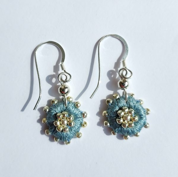 Light blue round embroidered drop earrings