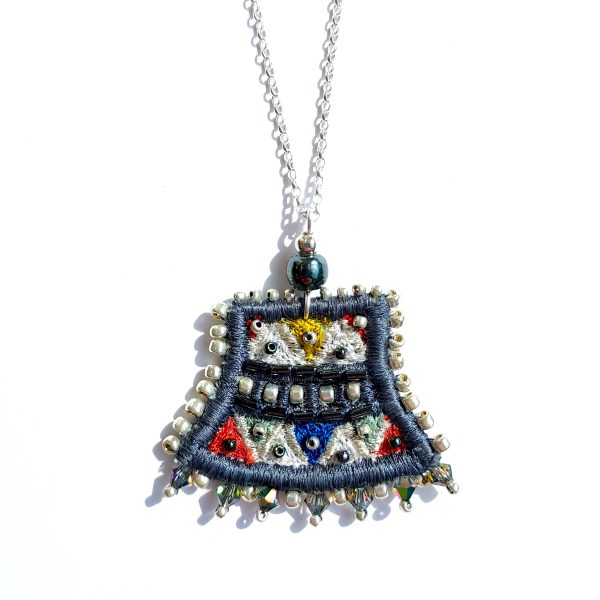 Embroidered slate coloured pendant on silver chain