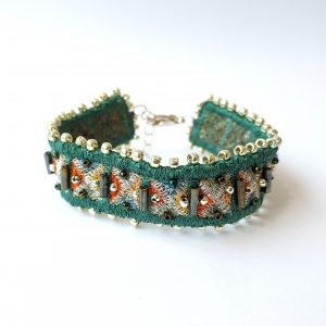 Green embroidered textile bracelet with silver fittings