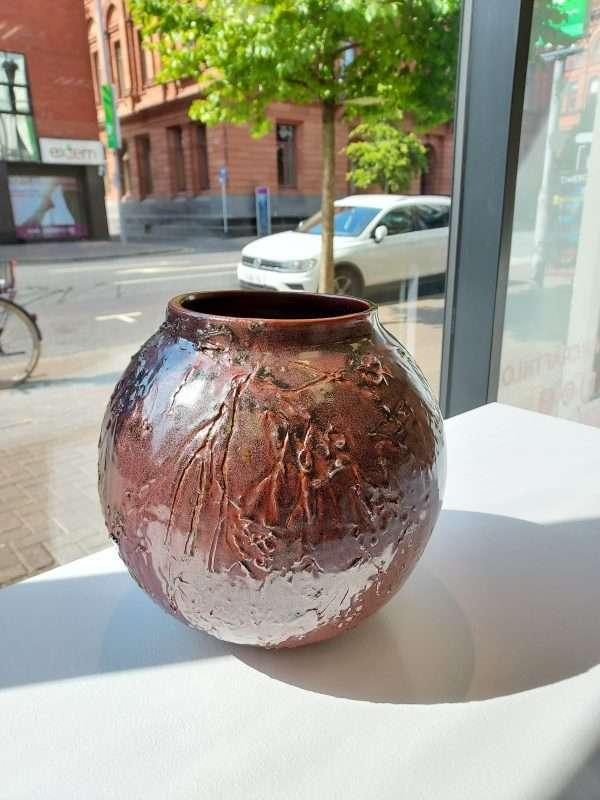 Large brown thrown ceramic earthenware jar