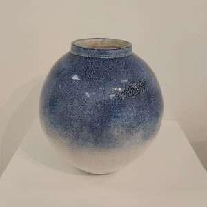 Round white and blue stoneware jar