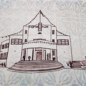 Detail of Cotten tea towel with blue pattern and illustration of Belfast Floral Hall