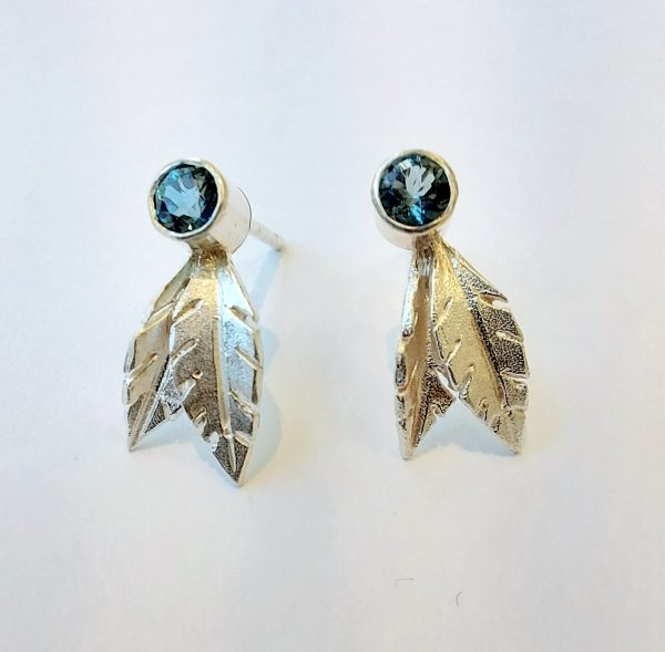 Silver leaf studs with blue topaz
