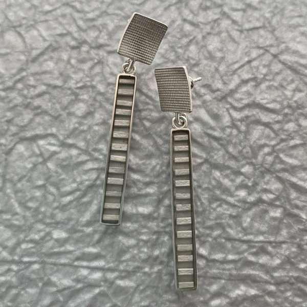 Silver line resin earrings by Carla Pennie McBride