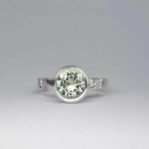 Round mint quartz bezel set in silver on textured band