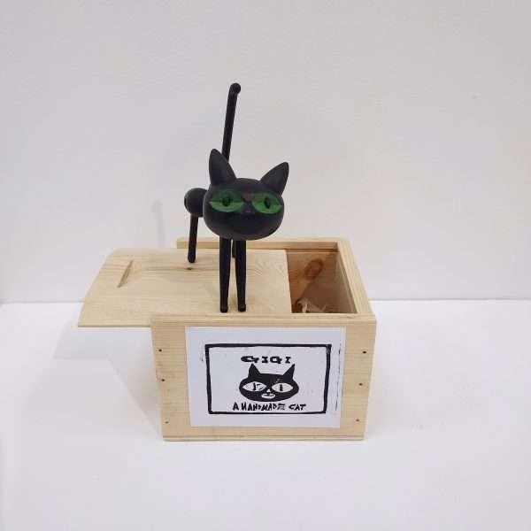 Black wooden cat on box