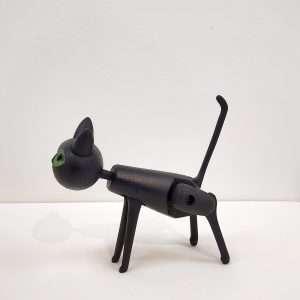 Handmade black wooden toy cat standing