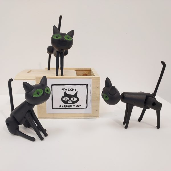 Collection of three black wooden toy cats with box